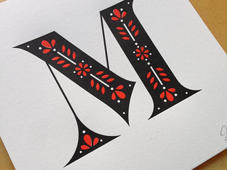 Decorative initial M letterpress print