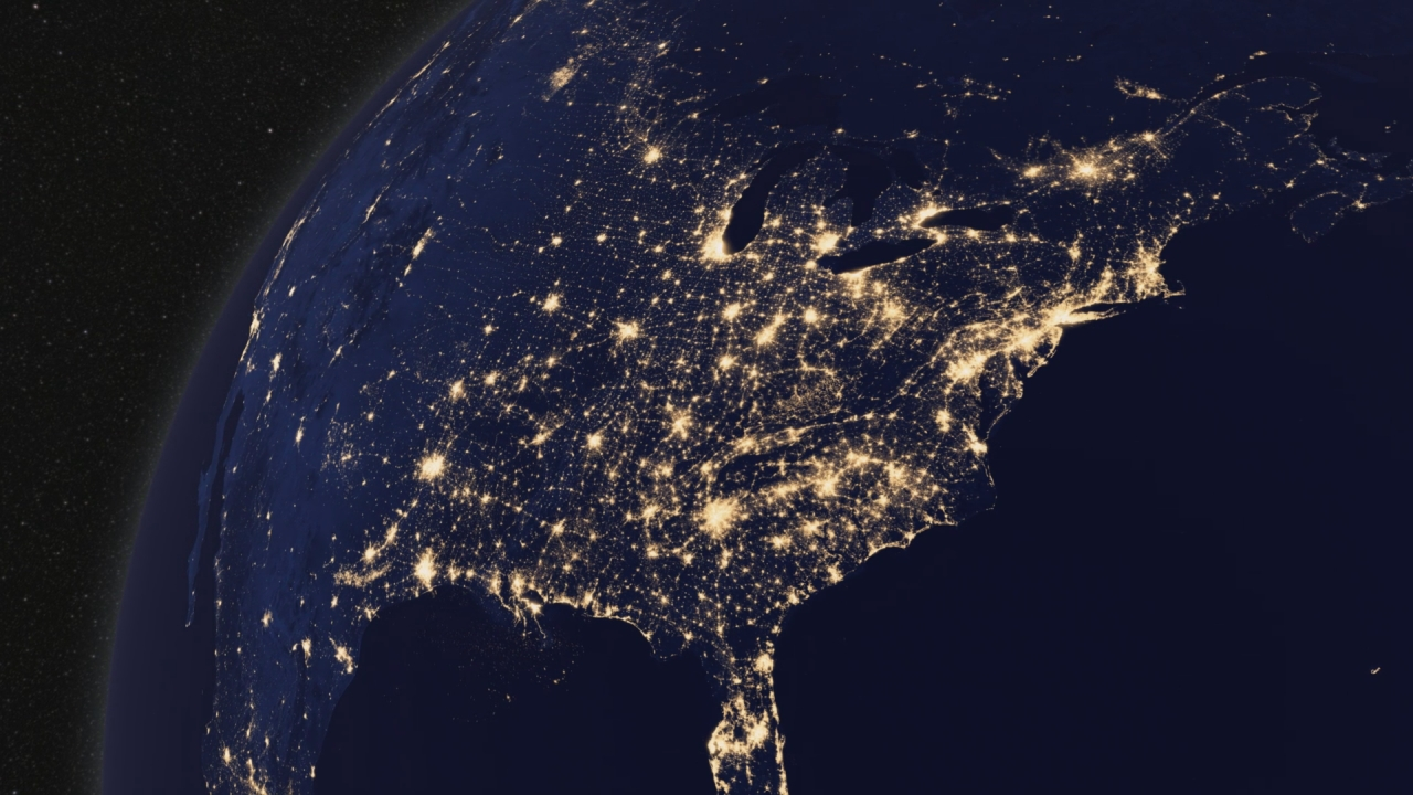 A satellite image of the earth showing the United States at night when artificial light is visible from space