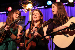 Jenni Lyn Gardner, Celia Woodsmith and Courtney Hartman of Della Mae at 2012 Wintergrass Festival © Bellevue.com