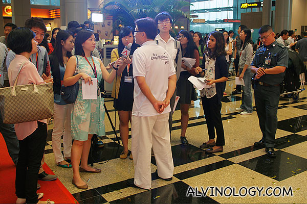 Mr Peh getting bombarded by the media after the event