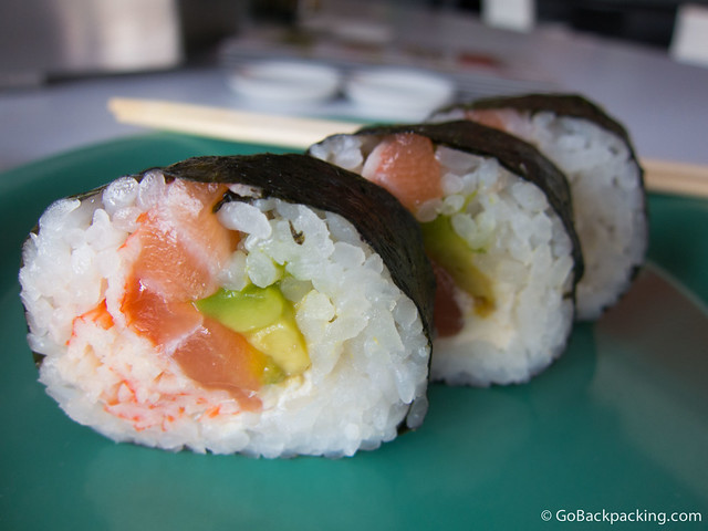 Roll with salmon, crab, avocado, and cheese