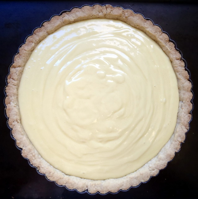 Pour the cream into your pre-baked tart shell and cover with plastic ...