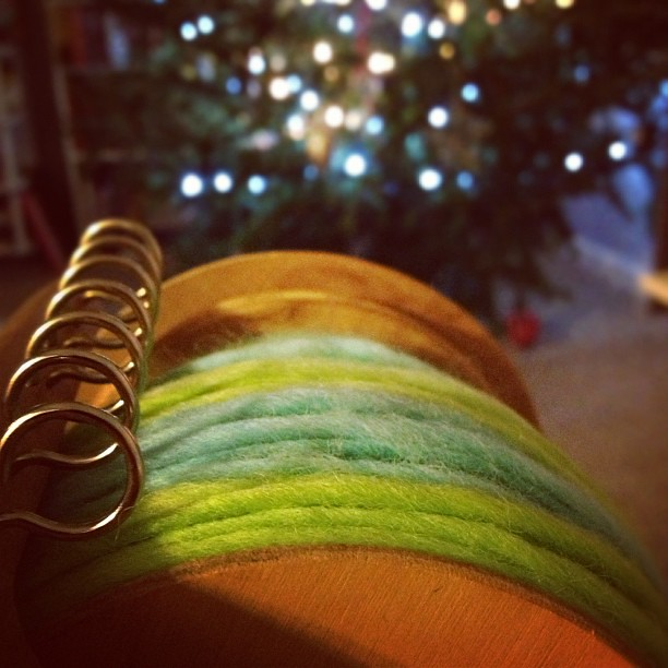 Spinning this month's Yarn Mail by Christmas tree-light.