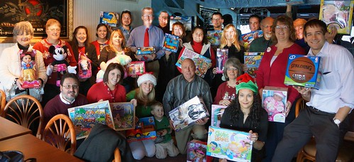The Pennsylvania Rural Development staff and the toys that were donated to local children in need through the U.S. Marine Corps Toys for Tots Toy Drive.