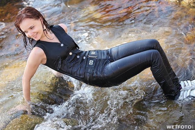 #240 Wetlook in Jeans Jumpsuit. Beautiful girl dressed in ...