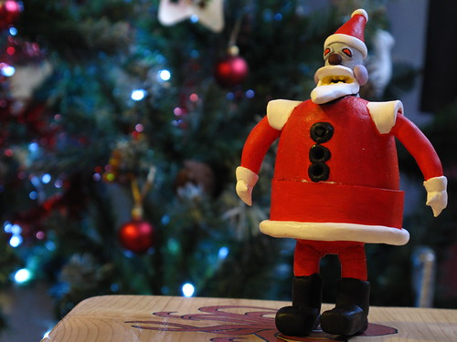 Robot santa deployed in front of the xmas tree