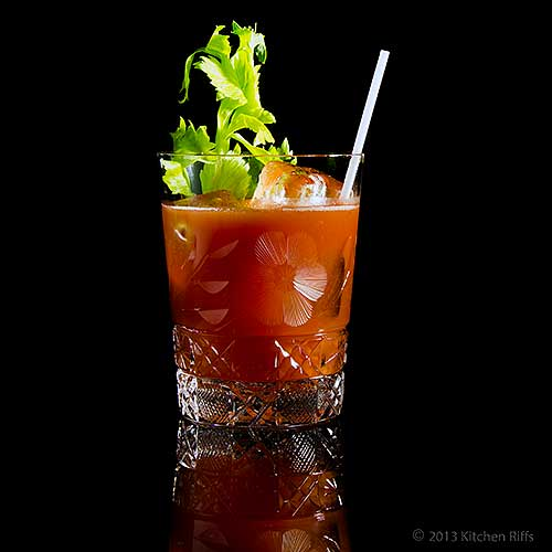 Bloody Mary Cocktail in Rocks Glass with Celery Garnish, on Black Acrylic