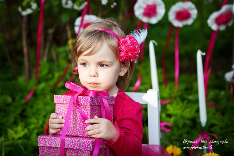 little girl with birthday presents