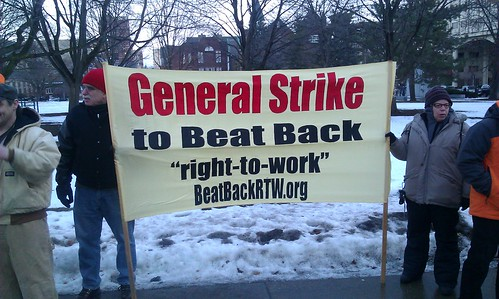 Members of the Moratorium NOW! Coalition hold banner calling for a general strike to combat right-to-work laws passed in Michigan. The demonstration organized by labor unions was held on January 9, 2013. (Photo: Abayomi Azikiwe) by Pan-African News Wire File Photos