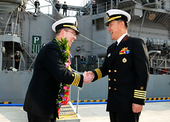 Capt. Jim T. Jones, Commander USS Shiloh (CG 67) is greeted by Republic of Korea (ROK) Navy Capt. Chui Sung Mock, Commander ROKS Choi Young (DDH 981) as the Ticonderoga-class Aegis guided-missile cruiser arrived at the Busan port.