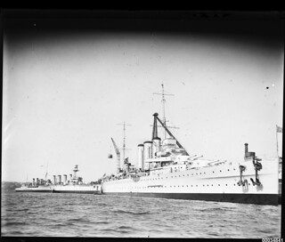 HMAS CANBERRA and other cruisers berthed near Garden Island