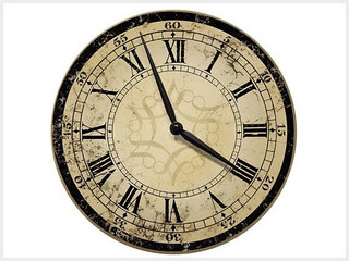 1. Decorative Ecru Architectural Wall Clock from Target – $25