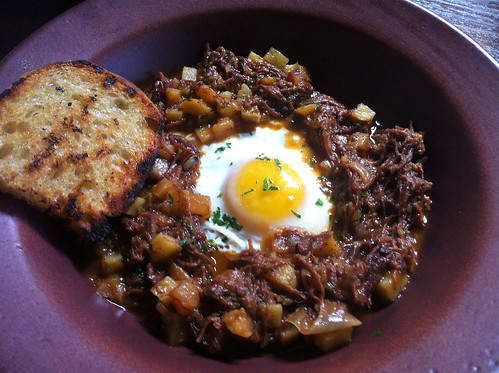 Braised Beef Short Rib Hash sunny-side up egg, sweet onions & roasted potatoes