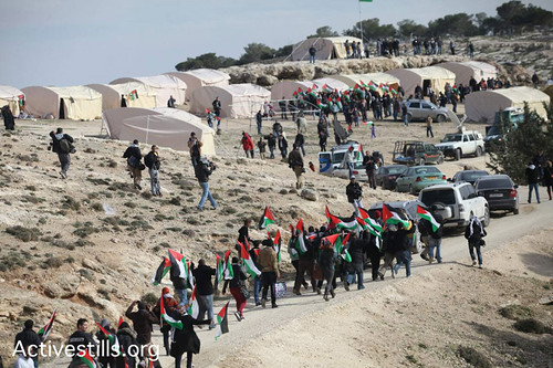 Activestills photo of Palestinian activists arriving today at Bab Al-Shams tent village