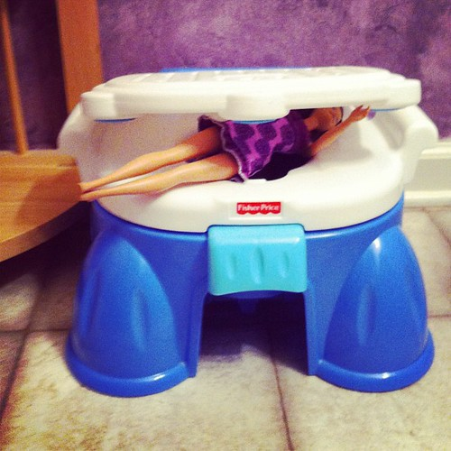 Lucy apparently wants to potty train her friends. (Poor Barbie.)
