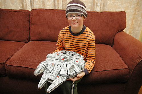 day 3103: odin shows off his lego millennium falcon. I.