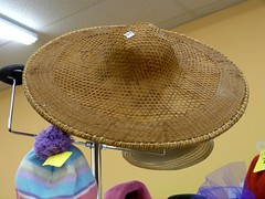 straw(0.0), cowboy hat(0.0), clothing(1.0), sun hat(1.0), sombrero(1.0), hat(1.0), circle(1.0), headgear(1.0),