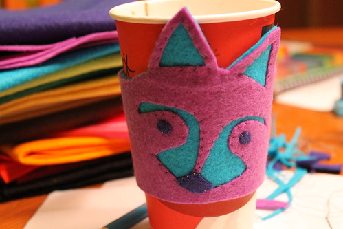 raccoon coffee cozy
