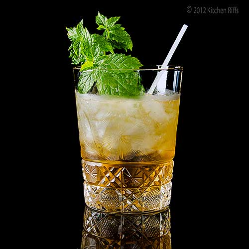 Stinger Cocktail in Rock Glass with Mint Garnish on Black Acrylic