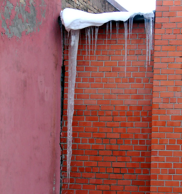 Icicle - not the smallest one now thawing by aigarsbruvelis