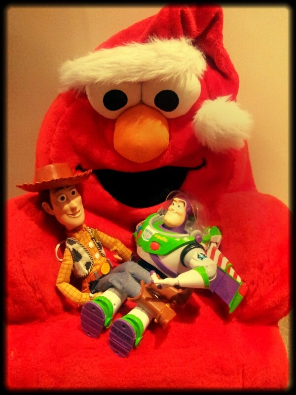 Elmo gets festive with Woody and Buzz