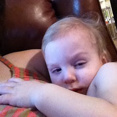 Sick boy cuddled with mommy