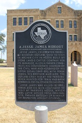 Photo of Jesse James, Frank James, Allen H. Parmer, and Susan Lavenia James black plaque