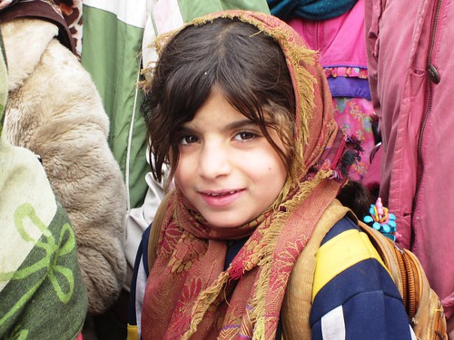 Kabul refugee children welcome winter clothes from ISAF volunteers