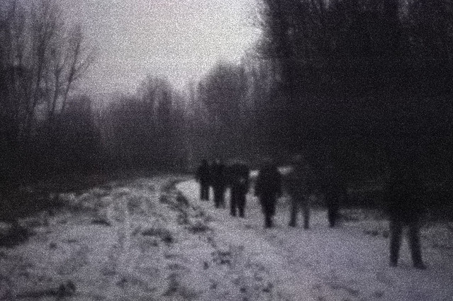 Columbia Bottom Conservation Area, in Saint Louis County, Missouri, USA - hikers in forest at night in the snow and fog 1