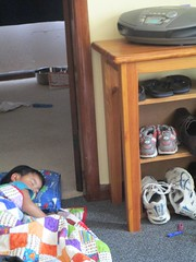 Sleeping in the doorway next to the CD player