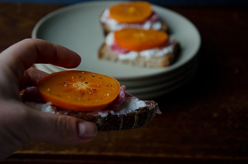 crostini with whipped ricotta, persimmon, and prosciutto