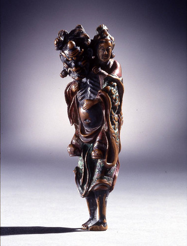 020-Netsuke- Rakan transportando a Kannon-Hecho de madera pintada-© Trustees of the British