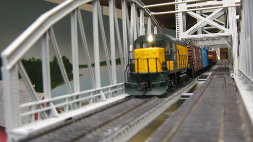 A Chicago & NorthWestern Railroad freight train crossing the Missisippi River lift bridge. by Eddie from Chicago