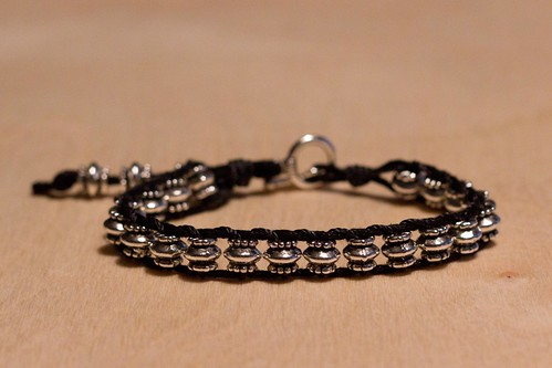 Ladder bracelet with metal beads