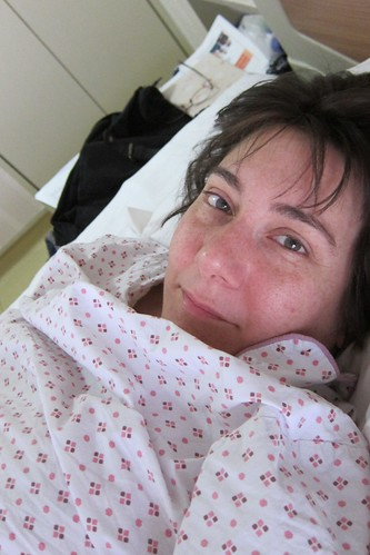 Self-portrait in hospital bed.