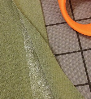 insert fusible webbing into hems before twin needle stitching