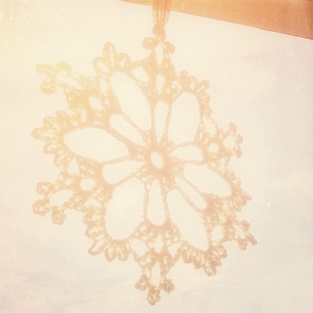 Crocheted snowflake hanging in the kitchen window on a hot and humid summer afternoon. I think irony might be the right term for it! #crochet #snowflake #christmas