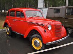 renault juvaquatre(0.0), compact car(0.0), automobile(1.0), automotive exterior(1.0), moskvitch 400-420(1.0), vehicle(1.0), antique car(1.0), sedan(1.0), vintage car(1.0), land vehicle(1.0), motor vehicle(1.0),