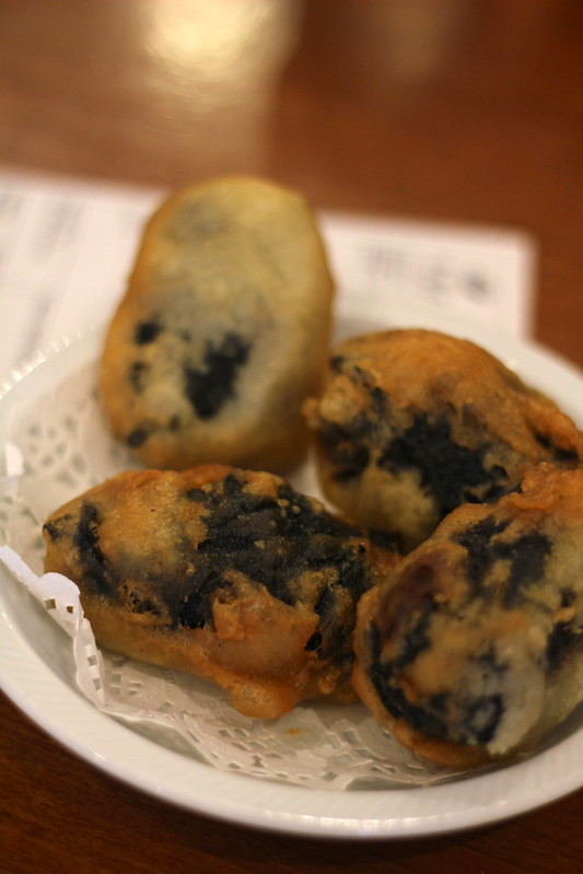 Mushrooms wrapped in nori with fake fish meat and deep fried
