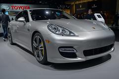 sports car(0.0), automobile(1.0), automotive exterior(1.0), executive car(1.0), family car(1.0), wheel(1.0), vehicle(1.0), performance car(1.0), automotive design(1.0), porsche(1.0), porsche panamera(1.0), rim(1.0), auto show(1.0), bumper(1.0), land vehicle(1.0), luxury vehicle(1.0),