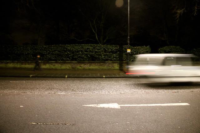 Car Speeds Past hyde Park, London