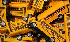 model car(0.0), truck(0.0), locomotive(0.0), construction equipment(0.0), bulldozer(0.0), yellow(1.0), vehicle(1.0), transport(1.0), school bus(1.0), land vehicle(1.0),