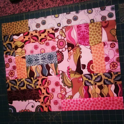 Using my leftover scraps! Wahoo! It feels good to not have a pile of random fabric that might not ever get used. :) glad my daughter now has a doll to make mini quilts for.  She might get a lot of them. ;)