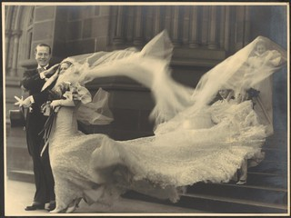 [Wind buffets the bride's veil and train at the wedding of Cyril Ritchard and Madge Elliott, St. Mary's Cathedral, Sydney, September 16, 1935]