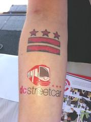 A DC Streetcar temporary tattoo alongside a genuine DC flag tattoo