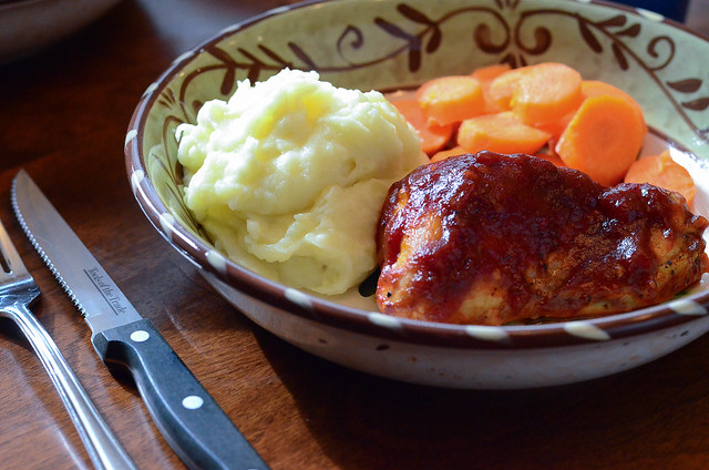 Tangy Oven Barbecue Chicken served with mashed potatoes and carrots.