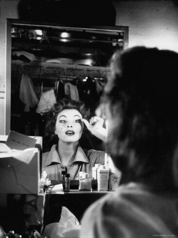 nina-leen-debutante-actress-tina-l-meyer-putting-on-false-eyelashes-in-dressing-room_i-G-27-2762-E2CTD00Z