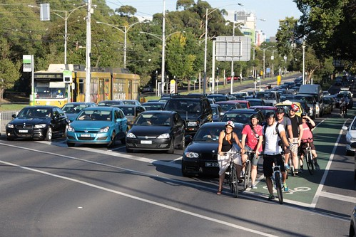 Queue of cyclists waiting at the traffic lights