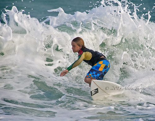 young and surfing by Alida's Photos
