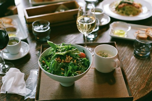 mixed salad, chinese spiced pork & sticky rice; potato soup; white wine.